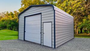 Detached metal garage with a walk-in door